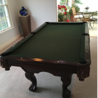Beautiful wood pool table for sale - owner moving and cannot take.